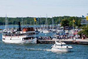 Vaxholm,Sweden - july 27,2012:Tourists arrive by boat to celebrate summer in Waxholm in Stockholm archipelago